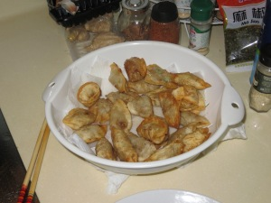 Fried Jiaozi, draining in a paper towel lined colander