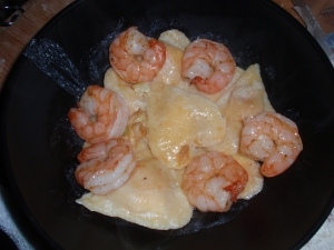 Ravioli tossed in garlic butter and a bit of white wine with shrimp.
