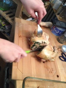 Slicing the chicken to serve