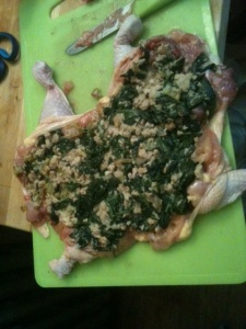 Deboned chicken with an even layer of spinach-pork stuffing