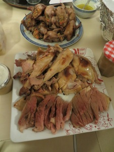 The roasted quail with butter-wine sauce poured over and a platter of sliced goose