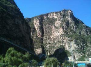 Blue, blue skies and steep cliffs.